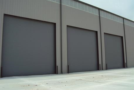 Service door - hospital IL Alegacy Business Park - Waller TX & hurricane garage doors for Wind Load Construction